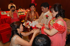 During the Ting Hun, the bride serves tea to the groom's family in order of seniority. Photo courtesy of Ms. Zyndee Co