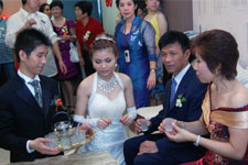 After the wedding ceremony, the bride serves tea to the groom's parents. Photo courtesy of Ms. Zyndee Co
