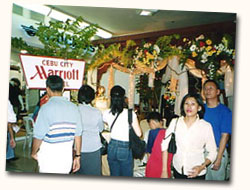 Event attendees admire the setup of Cebu City Marriott Hotel