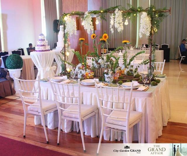 city garden grand hotel the grand affair sunflower themed table setup