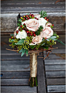 Bridal Bouquet with twigs, pine and berries from projectweddings.com