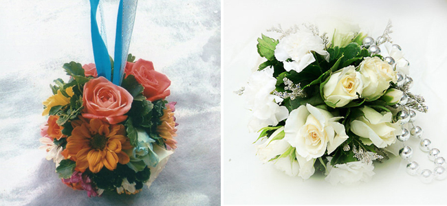 Left: A vibrant pomander bouquet, strung by a thick blue ribbon by Julius and Carol Flower Shop and Right: White-shade pomander bouquet connected by a beaded handle by Gemmas Flower Shop