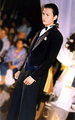 Traditional. The groom cuts a classic stance with the reliable tuxedo