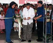 Ralyn Pigar of Visions and Ideas Events Management leads the ribbon-cutting ceremony of Weds Events at the Mega with husband Michael (in blue) and Pastor Butch de Leon (middle)
