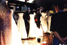 A row of gorgeous white gowns.