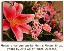 Flower arrangement by Mom's Flower Shop