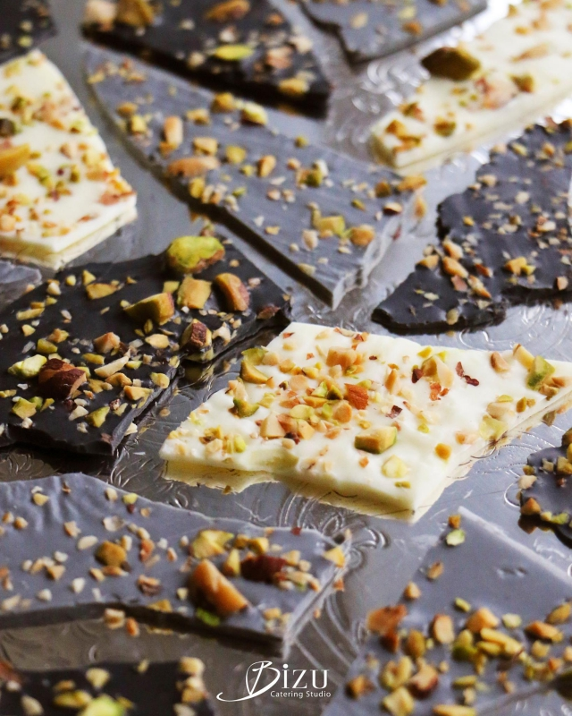 white milk and dark chocolate mendiant bark with crushed pistachios bizu catering studio